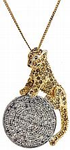 Leopard pendant with chain, 12 - 14 karat white and yellow gold, yellow diamond set cat perched on a white diamond set