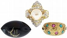 Rings- 3 (Three): The first 18 karat yellow gold, set with small cabochon rubies and turquoise, size 5 3/4, the next also 18 karat yellow gold, with filigree design, and set with 10mm pearl, and small diamonds, size 6 1/2, and an onyx and rutilated