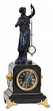 French, MYSTERY clock, time and bell strike, with Guilmet patent movement [signed], in a black marble case, accented with lions to the sides and with cast feet, the statue above carrying the glass lens pendulum, moving with no apparent impulse.
