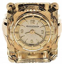 Jaeger LeCoultre Switzerland,. ring watch, 18 karat yellow gold set with a large, emerald cut citrine, back wind mechanical movement and dial mounted in a recess in the stone, size 4, 25.3g TW.