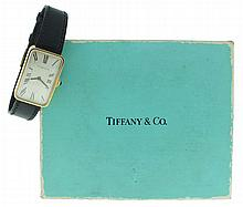 Tiffany & Co., New York, NY, gold wrist watch, manual winding,17 jewels Swiss nickel plate movement, with lever escapement in an 18 karat, yellow gold, oblong case with Roman numeral metal dial, and black baton hands, serial #67046, 32mm x 20mm,