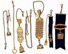 Chains and Fobs- 7 (Seven): All gold filled, 3 short chains, one with fob, two very nice fob chains, one with cameo, and two ribbon fob chains with ornamental mounts, lengths 4 1/2