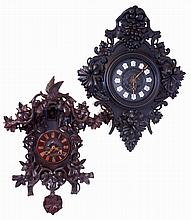 Clocks- 2 (Two) European carved walnut, 8 days, spring wound, time and strike wall clocks: French hanging clock with Paris retailer sticker inside, square brass movement; German Black Forest cuckoo, large movement with skeletonized cast brass plates;