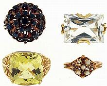 Rings- 4 (Four): One in 10 karat yellow gold and set with a large, cushion shaped citrine, size 8, another in 10 karat yellow gold, and set with a large, emerald cut goshenite, size 6 3/4, the next in 14 karat yellow gold and set with 18 small