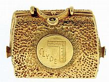 Valise form watch fob, 14 karat yellow gold, one side engraved with a carpenters square and the name