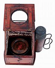 Negus, New York, wet compass, contained in a salt box form mahogany case with carrying handle, the lid with glazed viewing aperture, interior painted white, and with oil burning lamp attached to right side, compass with gimbal mount, serial #16951,