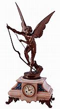 French figural mantel clock, cast spelter winged figure signed Mare Cassavetti on onyx and cast brass base with enameled plates, 8 days, time and strike, unsigned movement with count wheel and bell striking, c1890