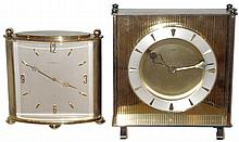 Clocks- 2 (Two) Angelus 15 jewel 8 days, brass and glass large Swiss desk clocks, 20th century