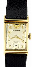 Hamilton Watch Co., Lancaster, Penn.. 982. 19 jewels. manual winding. straight line damascened nickel plate movement. with. lever escapement, in a. 14 karat yellow gold rectangular case. with. monogram on back