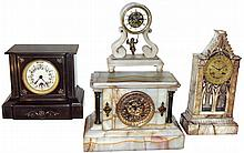 Clocks- 4 (Four) 8 days, marble case clocks: Boston Clock Co., black time and strike, tandem-wind; French Farcot swinging doll time-only with chaff-cutter escapement; Ansonia cream marble time and strike; French veined marble architectural time and