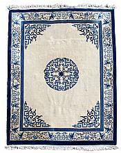 A modern Chinese carpet, with ivory field on navy blue grou