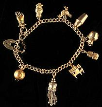An 18ct gold chain link charm bracelet, with 10 c