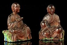 A pair of Chinese carved hardwood figures of seated Lohan, 18th century, on