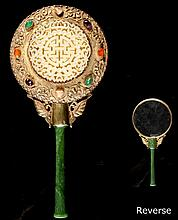 A good 19th century Chinese silver gilt hand mirror inset with multi colour