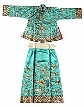 A Malay embroidered turquoise silk jacket and matching skirt (2) (see illus