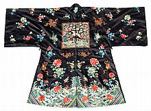 A Chinese embroidered silk long robe, late 19th / early 20th century, decor