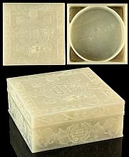 Property of a lady - a Chinese carved whitish very pale celadon jade square