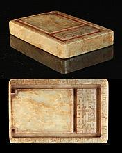 A Chinese mottled celadon jade rectangular inkstone, with shallow carved dr