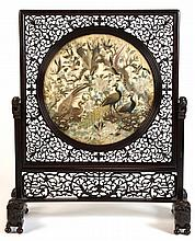 A good late 19th century Chinese carved hongmu table screen with embroidere