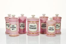 Seven Pink and White Porcelain Apothecary Jars
