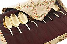 Set of eight gilt and silver plated serving spoons