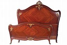 Large Napoleon III period Louis XV style mahogany and ormolu mounted bed