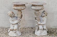 PAIR OF CAST-IRON CHERUB SUPPORTED JARDINIERES