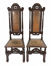 Pair of late nineteenth-century carved oak and leather panelled ceremonial hall seats