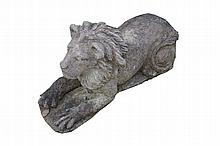 Two cast stone patinated lions