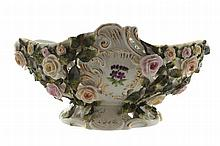German porcelain footed flower encrusted and reticulated fruit bowl of oval form