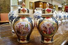 Pair of nineteenth-century Vienna porcelain urns and covers