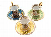 Group of three Royal Vienna porcelain cups and saucers