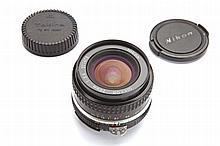 Nikkor 20 mm. 3.5 lens and leaflet