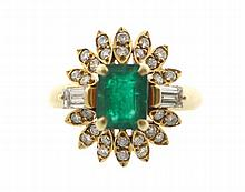 Single emerald and 30 diamond yellow gold cluster ring