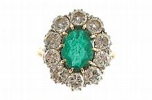 18 ct. gold emerald and diamond ring