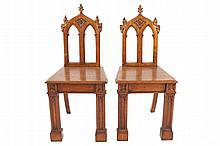 Pair of oak late nineteenth-century Gothic hall chairs