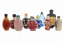 Chinese Qing period Group of twelve glass porcelain and bone snuff bottles