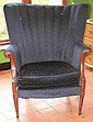Upholstered wing back armchair