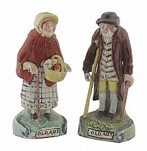 Pair of early Staffordshire figures