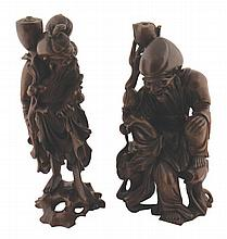 Pair of Chinese Qing period carved hardwood figures of Immortals