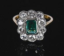 18 ct. white gold 1.5 ct. diamond and 1.10 ct. emerald ring