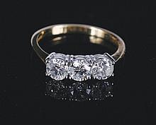 18 ct. yellow gold and diamond three stone ring of 1.5 ct of diamonds