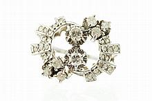 18 ct. white gold and cluster diamond ring