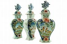 Set of three nineteenth-century Delft polychrome urns and covers