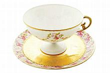Nineteenth-century parcel gilt porcelain coffee cup and saucer