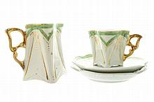 Miniature porcelain coffee cup, milk jug and two saucers