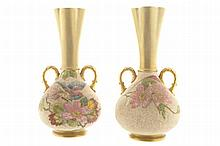 Pair of nineteenth-century parcel gilt and sand ground painted vases