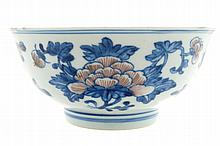 A Chinese blue and copper-red floral bowl, seal mark of Qianlong (1736-1795).