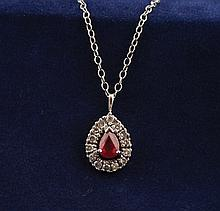 Ruby and diamond 18 ct. gold pendant and chain