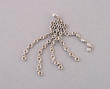 White gold and diamond pendant         4 cm. long